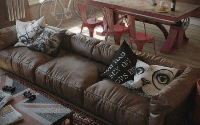 Sleek Brown Leather Sofa Design And Animals Pillow